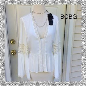 New BCBG Top that will Turn heads w bell sleeves